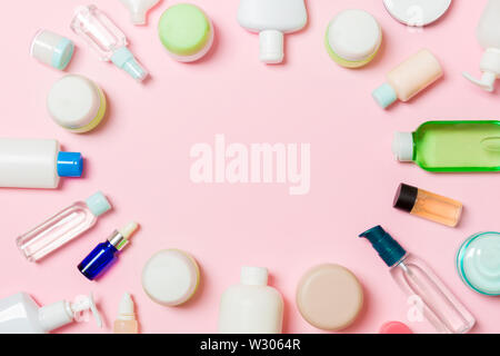 Frame of plastic bodycare bottle Flat lay composition with cosmetic products on pink background empty space for you design. Set of White Cosmetic cont - Stock Image