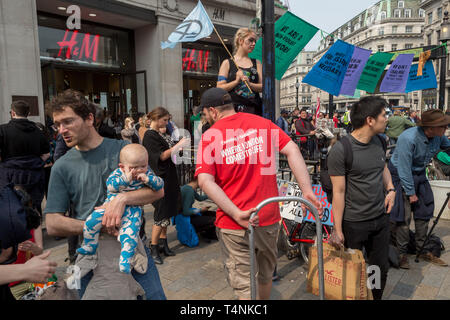 Activists with Extinction Rebellion protest about climate change in a blocked-off Oxford Circus, on 17th April 2019, in London, England. - Stock Image