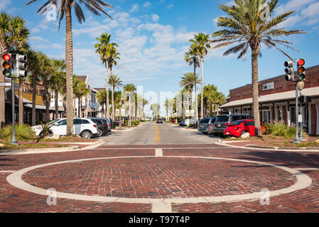 Beach town local restaurants line the street between Florida A1A and Ocean Boulevard at the dividing line between Atlantic Beach and Neptune Beach, FL. - Stock Image