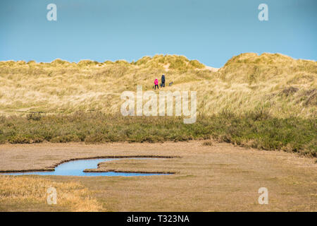 Sand dunes where Norfolk Coast path National Trail from Barnham Overy Staithe reaches the sea, East Anglia, England, UK. - Stock Image