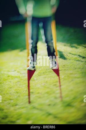 girl on stilts - Stock Image