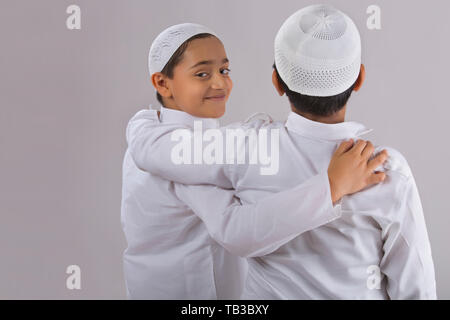 One young Muslim boy looking back and backside of other - Stock Image