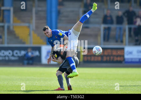 Carlisle United's Nathan Thomas and Lincoln City's Tom Prett compete for a header during the Sky Bet Championship match at Brunton Park, Carlisle. - Stock Image