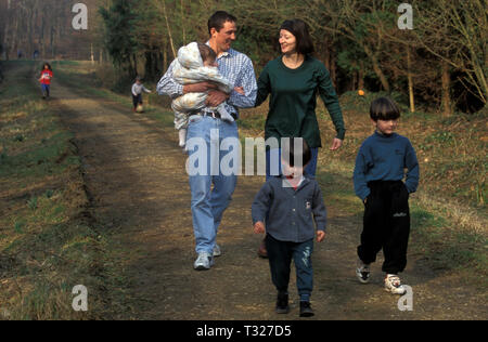 Young family walking in Firestone Copse, Wooton, Isle of Wight, England - Stock Image