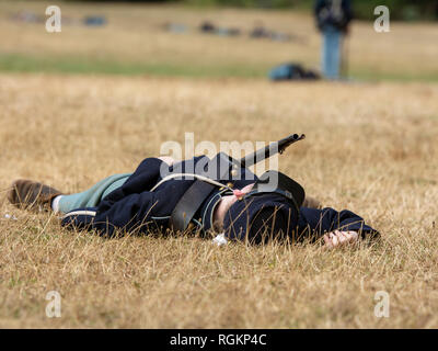 Duncan Mills, CA - July 14, 2018: Reenactor playing dead union solder at a Civil war reenactment - Stock Image