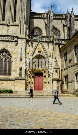 Ornate Cathedral of Saint Corentin side entry in Quimper, Brittany, France. - Stock Image