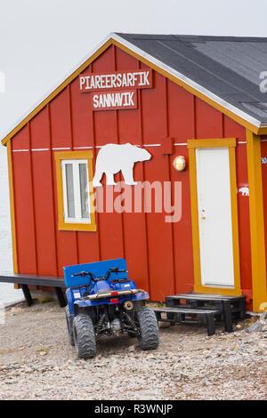 Greenland. Scoresby Sund. Ittoqqortoormiit. ATV outside of a school - Stock Image
