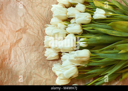 Fresh flower composition, bouquet white tulips on craft paper background. Valentine, Women's, 8 march, birthday, - Stock Image
