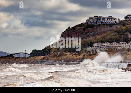 Large waves breaking over the seafront at Colwyn Bay on the North Wales coast - Stock Image