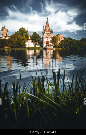 Laxenburg castle (Franzensburg) near Vienna (Austria) with the lake in the foreground - Stock Image