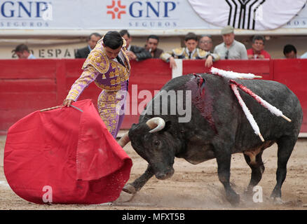 Mexican Diego Sanchez performs a pass during a bullfighting as part of National Fair of San Marcos at Monumental bullring in Aguascalientes, Mexico, 26 April 2018. EFE/Mario Guzman - Stock Image
