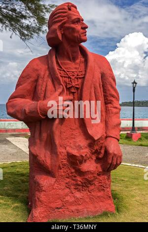 The Statue of Christopher Columbus hewn out of giant stump of wood in Baracoa Waterfront. Columbus landed in Cuba on the 27th of November 1492 - Stock Image