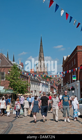 Crowds in Lichfield Market Place walk towards the Cathedral for the Florette Festival Market on Saturday 6th July - Stock Image
