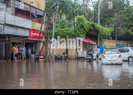 Flooded streets in downtown New Delhi, India. - Stock Image