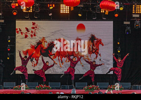 London, UK, 10 February, 2019. Chinese New year celebration at Trafalgar square , London, UK. Group perfromance by Mongolian Man on stage. Credit: Harishkumar Shah/Alamy Live News - Stock Image