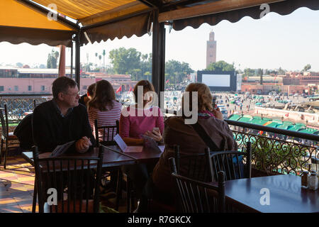 Tourists in the Cafe de France cafe, Djemaa el Fna Square, Marrakech, Morocco North Africa - Stock Image