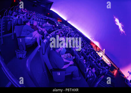 Garden City, New York, USA. June 21, 2018. NASA space shuttle astronaut MIKE MASSIMINO, a Long Island native, is on stage giving free lecture to audience in the JetBlue Sky Theater Planetarium at the Cradle of Aviation Museum. - Stock Image