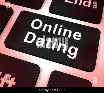 Online Dating Computer Key Shows Romance And Web Love - Stock Image