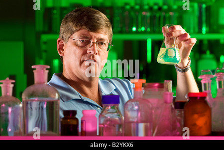 A chemical engineer for the petroleum industry pictured in his scientific laboratory. - Stock Image