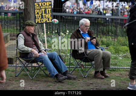 Two male protestors sitting on seats, People's Vote March, London, England - Stock Image