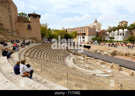 Tourists at the ruins of El Teatro Romano, or Roman Theatre, built in the 1st century BC, Malaga old town, Malaga Spain - Stock Image