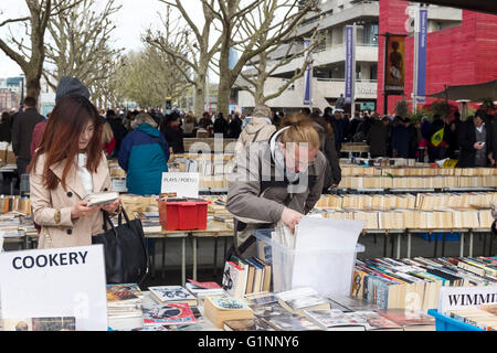 People browsing at the Southbank Centre Book Market in London UK - Stock Image