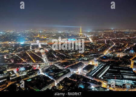 Aerial View Paris Cityscape at Night. Beautiful City Skyline and Famous Landmarks, Illuminated with Light in Dark Evening Time in Paris, France - Stock Image