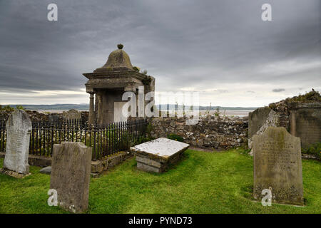 Clouds over cemetery at The Parish Church of Saint Mary the Virgin on tidal Island of Holy Island of Lindisfarne England UK - Stock Image