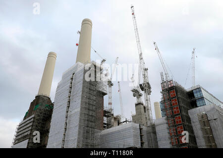 A low angle view of Battersea Power Station under construction during redevelopment & cranes in Wandsworth South London SW8 England UK  KATHY DEWITT - Stock Image