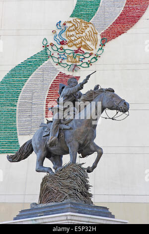 Statue of Pancho Villa riding on a running horse pointing a revolver in Chihuahua City, Chihuahua, Mexico. - Stock Image
