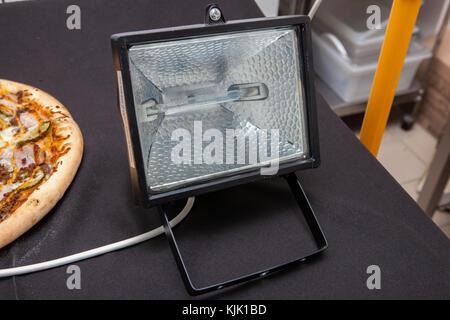 searchlight, light bulb - Stock Image