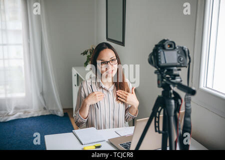 Girl blogger records video for their subscribers. Infobusiness or information business or hobby or online training or education for people. - Stock Image