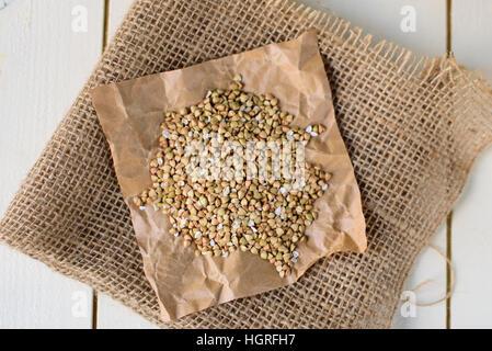 Buckwheat on white wooden background - Stock Image