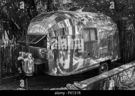 A 1950s Airstream Bubble travel trailer. Black & white. - Stock Image