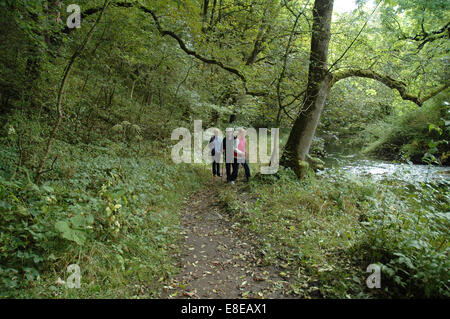 3 adults walking in the Peak District, Derbyshire - Stock Image