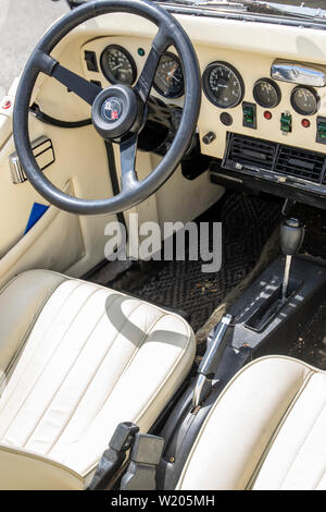 Steering wheel and dashboard of a vintage Excalibur car - Stock Image