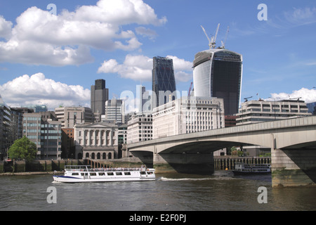 London Bridge and skyline view from River Thames June 2014 - Stock Image