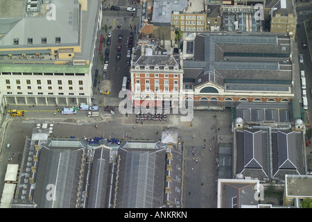 Aerial view of a Street Cafe outside London's Covent Garden Market surrounded by utilities work - Stock Image
