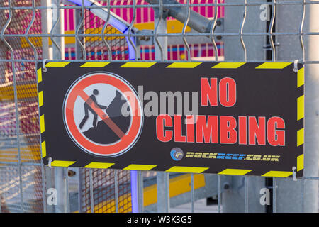 No Climbing sign on zipwire launch tower at Bournemouth Pier, Bournemouth, Dorset UK in July - Stock Image