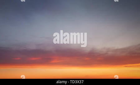 cloudscape at sunset with beautiful sky gradient and some clouds - Stock Image