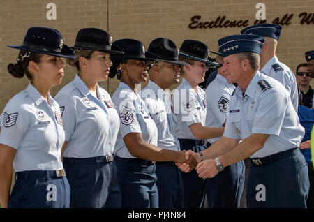 U.S. Air Force Chief of Staff Gen. David L. Goldfein visits with military training instructors during a basic military training graduation Aug. 30, 2018, at Joint Base San Antonio-Lackland, Texas. Every enlisted Airman begins their Air Force career at basic military training. JBSA-Lackland is often referred to as the 'Gateway to the Air Force,' graduating about 39,000 Airmen annually. Goldfein served as the reviewing official and Chief Master Sgt. of the Air Force Kaleth O. Wright served as the guest speaker for the graduation. - Stock Image
