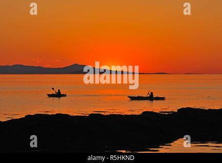 Evening paddle in the last rays of sunlight on Vancouver Island BC Canada. - Stock Image