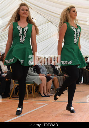 The Prince of Wales and the Duchess of Cornwall watch Irish dancers during their visit Glencree Peace and Reconciliation Centre in Glencree, Co Wicklow, on the first day of the Royal couple's visit to Ireland. - Stock Image
