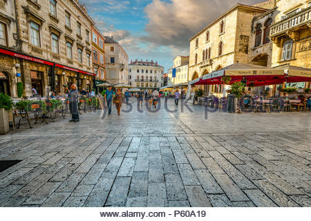 Morning at the People's Square inside the Diocletian's Palace area of Old Town Split, Croatia as tourists and locals start the day - Stock Image