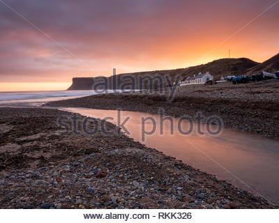 Saltburn-by-the-Sea. 12th Feb 2019. Weather: Sunrise on the coast at Saltburn-by-the-Sea on the north-east coast with Hunt Cliff in the background. 12th February 2019. © Gary Clarke/Alamy Live News - Stock Image