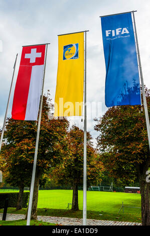 Flags flying at the entrance to the headquarters of FIFA in Zurich, Switzerland - Stock Image