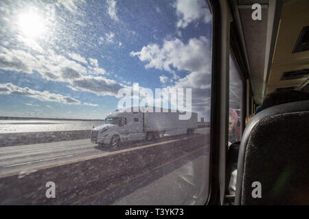 MONTREAL, CANADA - NOVEMBER 10, 2018: North American truck seen from the large window of a coach on a Quebec highway in the suburbs of Montreal, seats - Stock Image