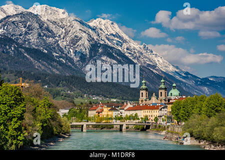 View of center of Innsbruck from bridge over Inn River, Nordkette massif in distance, Innsbruck, Tyrol, Austria - Stock Image