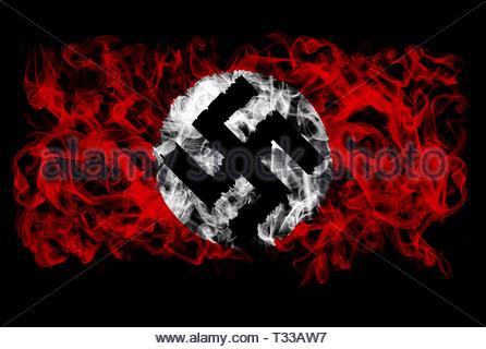Smoking flag of Nazi Germany - Stock Image