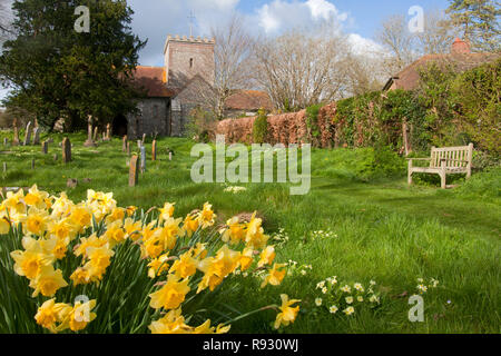 All Saints flint church in East Dean, a village in the South Downs National Park near Chichester, West Sussex - Stock Image